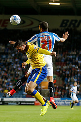 Andrew Taylor of Wigan and Nahki Wells of Huddersfield compete in the air - Photo mandatory by-line: Rogan Thomson/JMP - 07966 386802 - 16/09/2014 - SPORT - FOOTBALL - Huddersfield, England - The John Smith's Stadium - Huddersfield Town v Wigan Athletic - Sky Bet Championship.