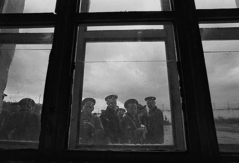 Russian young prisoners look through the window during morning stroll at the colony for prisoner's children in Siberian town Leninsk-Kuznetsky, Russia, 26 September 2000.