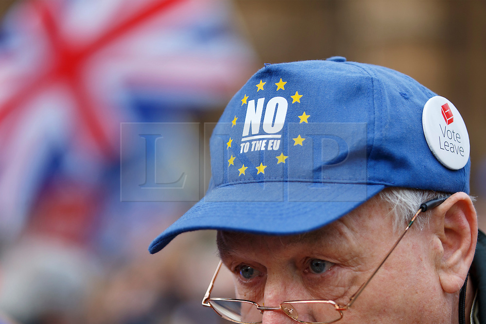 © Licensed to London News Pictures. 23/11/2016. London, UK. Demonstration takes place outside The Houses of Parliament in London to oppose the High Court's ruling earlier this month that the Article 50 process must be triggered by an act of Parliament. Photo credit: Tolga Akmen/LNP