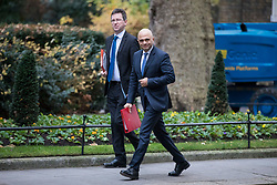 © Licensed to London News Pictures. 05/12/2017. London, UK. Secretary of State for Communities and Local Government Sajid Javid (R) and Attorney General Jeremy Wright (L) arrive on Downing Street for the weekly Cabinet meeting. Photo credit: Rob Pinney/LNP