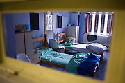 A view through the door of a first night 4 person dorm at HMP Holloway, the main womens prison in London. suite at HMP Holloway, the main womens prison in London.