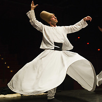 VENICE, ITALY - JUNE 21:  A whirling Dervish of the Galata Mevlevi Ensemble perfoms at Auditorium Candiani on June 21, 2011 in Venice, Italy. The whirling dance associated with Dervishes, is the practice of the Mevlevi Order in Turkey, and is part of a formal ceremony known as the Sema which is only one of the many Sufi ceremonies performed to try to reach religious ecstasy