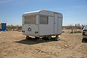 single old caravan parked by the beach
