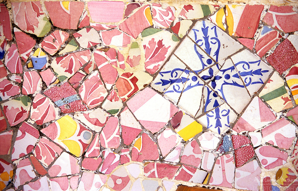 Details of mosic tiles on the wavy bench in Antoni Gaudi's Park Guell is a UNESCO World Heritage Site.
