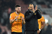 Wolverhampton Wanderers manager Nuno Espirito Santo and Matt Doherty (2) of Wolverhampton Wanderers applaud the fans as they celebrate the 2-1 win at full time during the Premier League match between Bournemouth and Wolverhampton Wanderers at the Vitality Stadium, Bournemouth, England on 23 November 2019.