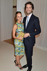 PETRA PALUMBO and SIMON LOVAT at a dinner hosted by Cartier in celebration of The Chelsea Flower Show held at The Hurlingham Club, London on 19th May 2014.