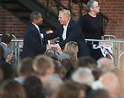 Ohio University President Dr. Roderick McDavis shakes hands with former Ohio Governer Ted Strickland at a rally for President Obama on the campus of Ohio University in Athens, Ohio. Photo by Ben Siegel/ Ohio University
