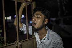 July 4, 2017 - Gazipur, Dhaka, Bangladesh - A man cries as his relative died after a boiler explosion in a factory in Bangladesh. At least nine people have been killed and more than 50 others injured as a boiler of a garment factory of Multifabs Ltd exploded in Gazipur, Bangladesh on Monday evening, 3 July 2017. (Credit Image: © Probal Rashid via ZUMA Wire)