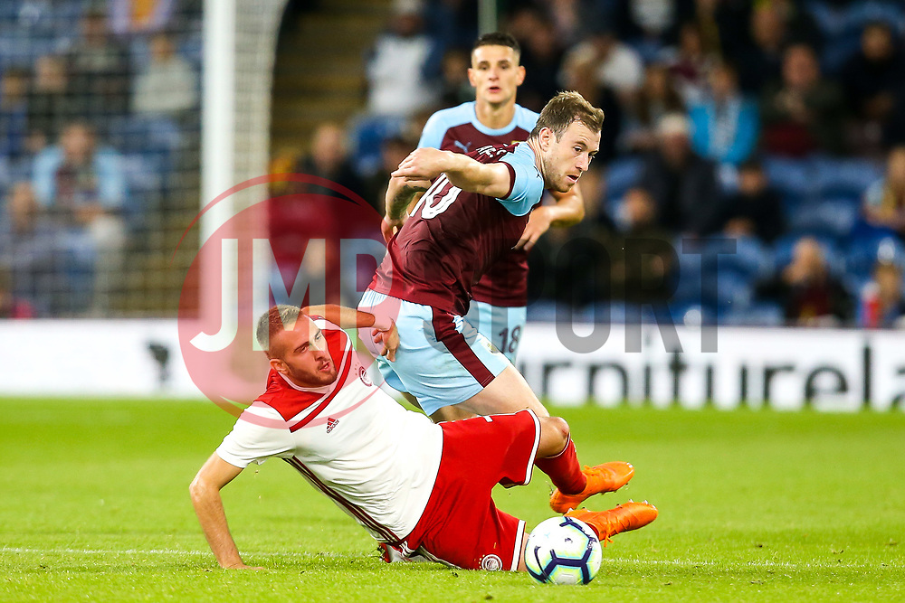 Ashley Barnes of Burnley takes on Kostas Fortounis of Olympiakos - Mandatory by-line: Robbie Stephenson/JMP - 30/08/2018 - FOOTBALL - Turf Moor - Burnley, England - Burnley v Olympiakos - UEFA Europa League Play-offs second leg