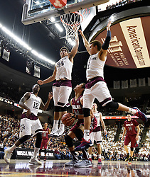 South Carolina's Michael Carrera (24) tries to put up a shot between Texas A&M's Tyler Davis (34) and D.J. Hogg (1) during the second half of an NCAA college basketball game, Saturday, Feb. 6, 2016, in College Station, Texas. South Carolina won 81-78. (AP Photo/Sam Craft)