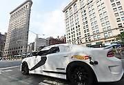 A Hot Wheels Star Wars First Order Stormtrooper Dodge vehicle, modeled after the new Hot Wheels line of Star Wars character cars, drives past the Flatiron building in New York, Friday, Sept. 4, 2015, to celebrate Force Friday.  (Photo by Diane Bondareff/Invision for Mattel/AP Images)