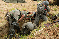 Reenactors portraying a Mortar team from the Panzer Grenadier Division Großdeutschland firing an 8 cm Granatwerfer 34 (8 cm GrW 34) which was the standard German infantry mortar throughout World War II