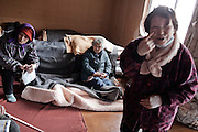 Japanese people fill an evacuation center trying to keep warm as winter weather made a miserable situation worse on March 23, 2011 in Miyagi, Japan
