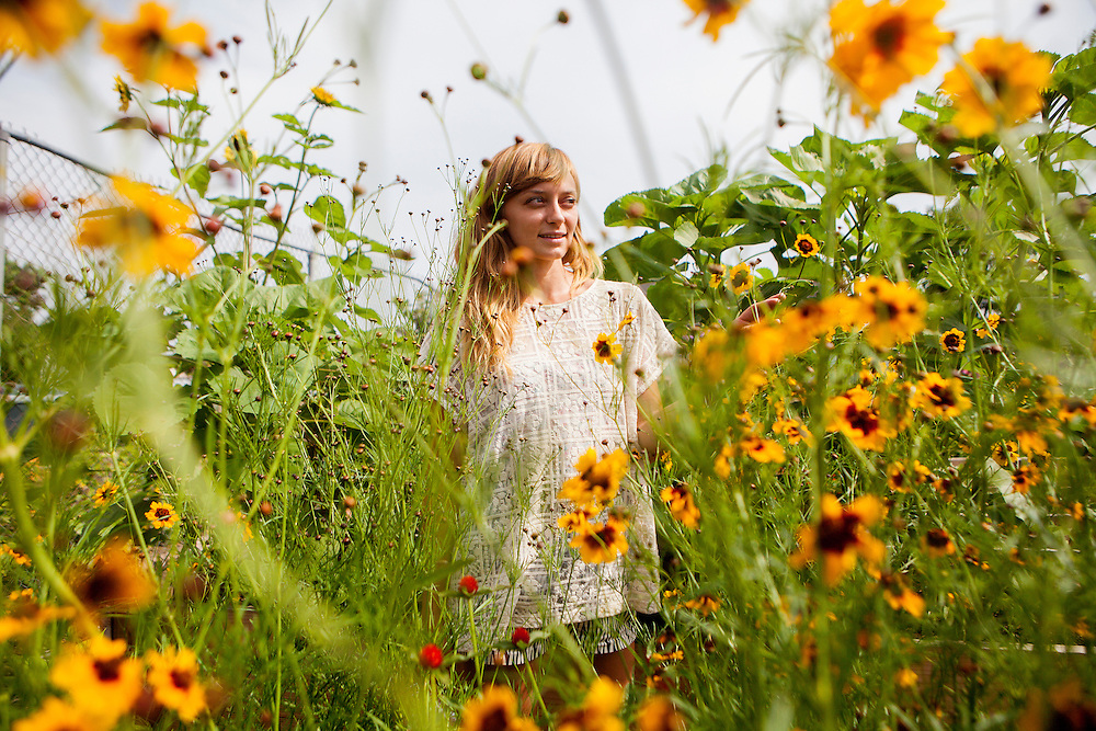 QUEENS, N.Y. - JULY 9, 2015: Isabella Scott poses for a portrait before harvesting flowers from the Rockaway Dye Garden. Ms. Scott uses the flowers for natural dyeing and textile arts. CREDIT: Sam Hodgson for The New York Times