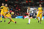 Harry Kane of Tottenham Hotspur (10) shoots at goal during the Premier League match between Tottenham Hotspur and Brighton and Hove Albion at Wembley Stadium, London, England on 13 December 2017. Photo by Matthew Redman.