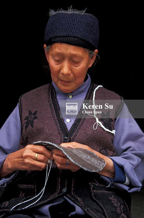 An elderly woman sewing a sole (MR), Daching, Sichuan Province, Three Gorges, Yangtze River, China