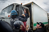 ITALY, GIUGLIANO : Riot police try to block a woman that tries to stop a waste lorry truck outside the Taverna del Re dump in Giugliano on November 2, 2010. Demonstrators protest against the re-opening of the Taverna del Re dump taht contains more than six milion tons of garbage. AFP PHOTO / ROBERTO SALOMONE