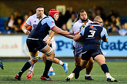 Pierre Schoeman of Edinburgh Rugby is challenged by Dmitri Arhip of Cardiff Blues - Mandatory by-line: Ryan Hiscott/JMP - 05/10/2019 - RUGBY - Cardiff Arms Park - Cardiff, Wales - Cardiff Blues v Edinburgh Rugby - Guinness Pro 14