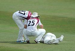 Josh Cobb of Northamptonshire goes down injured  - Photo mandatory by-line: Dougie Allward/JMP - Mobile: 07966 386802 - 09/07/2015 - SPORT - Cricket - Cheltenham - Cheltenham College - LV=County Championship 2