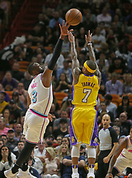 March 1, 2018 - Miami, FL, USA - The Los Angeles Lakers' Isaiah Thomas, right, shoots over the Miami Heat's Dwyane Wade during the first quarter at the AmericanAirlines Arena in Miami on Thursday, March 1, 2018. The Lakers won, 131-113. (Credit Image: © David Santiago/TNS via ZUMA Wire)