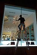 D Dong Khoi main shopping street. Dolce & Gabbana. Window cleaner.