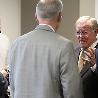 Dr. Ed Hill, left, talks with friends at the North Mississippi Medical Center, during his retirement reception Friday afternoon that honored his 22 years of service.