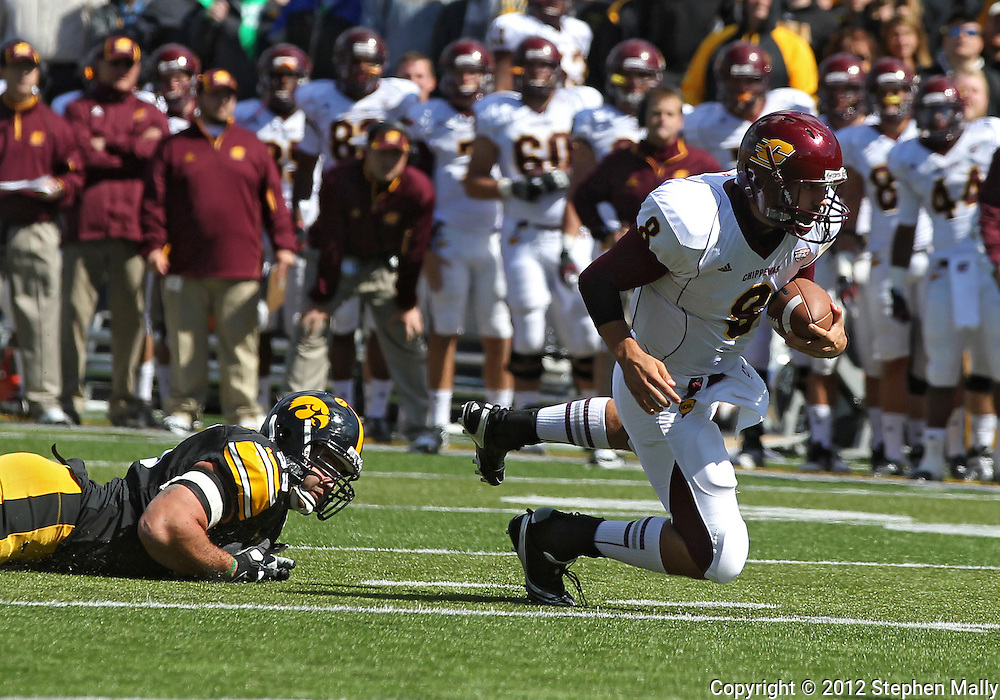 September 22 2012: Central Michigan Chippewas quarterback Ryan Radcliff (8) is tripped up by Iowa Hawkeyes defensive lineman Joe Gaglione (99) during the first half of the NCAA football game between the Central Michigan Chippewas and the Iowa Hawkeyes at Kinnick Stadium in Iowa City, Iowa on Saturday September 22, 2012. Central Michigan defeated Iowa 32-31.