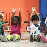Lauren Wood | Buy at photos.djournal.com<br /> Students stretch as they do a cool down from dancing with Mary Frances Massey Friday morning during music at ECEC.