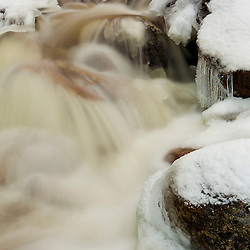 Silver Cascade in winter in Crawford Notch State Park. White Mountains, New Hampshire.