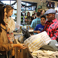 Jamie Bailey, right, checks out customers at Robin's Unique Boutique during a previous Aberdeen Main Street Christmas Open House, a one-day event each November providing a huge boost for sales tax. City leaders are encouraging people to primarily shop local to increase sales tax to help with several improvement goals.