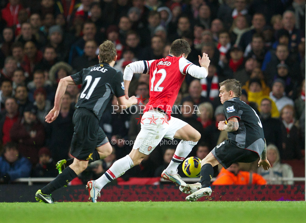 LONDON, ENGLAND - Wednesday, January 30, 2013: Liverpool's Daniel Agger tackles Arsenal's Oliver Giroud during the Premiership match at the Emirates Stadium. (Pic by David Rawcliffe/Propaganda)