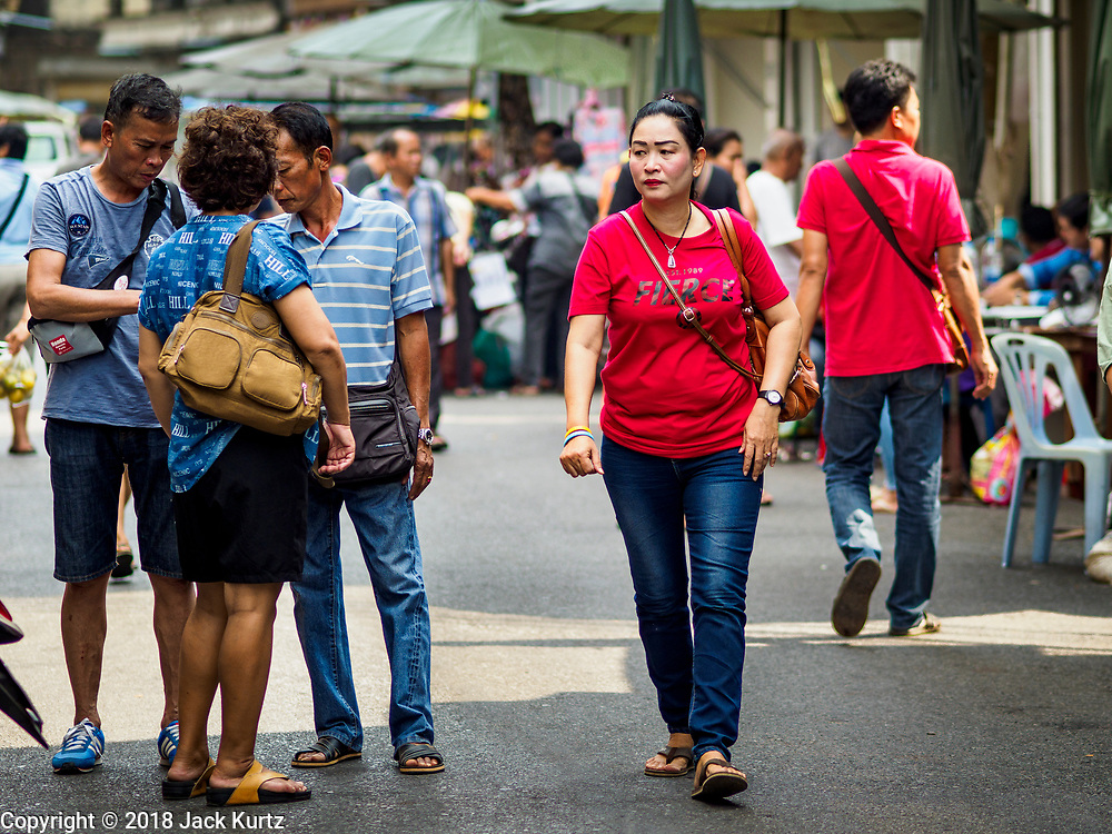 22 DECEMBER 2018 - CHANTABURI, THAILAND: People walk through the gem market in Chantaburi. The gem market in Chantaburi, a provincial town in eastern Thailand, is open on weekends. Chantaburi used to be an active gem mining area in Thailand, but the mines are played out now. Now buyers and sellers come from around the world to Chantaburi for the weekend market. Many of the stones come from Myanmar, others come from mines in Afghanistan and Africa.       PHOTO BY JACK KURTZ