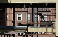 Newburgh, New York - A man stands on a lift as construction continues on Kaplan Hall at Orange County Community College's Newburgh campus on March 17, 2010. Kaplan Hall will be a state-of-the-art, 87,000 sq. ft. environmentally friendly building.