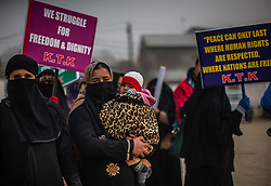 December 10, 2016 - Srinagar, Jammu and Kashmir, India - Leaders and activist of Kashmir Tehreek-e-Khawateen (KTK) a women's pro Kashmir resistance organization shout anti Indian slogans during a protest to mark the World Human Rights Day on December 10, 2016 in Srinagar, the summer capital of Indian administered Kashmir, India. Indian government forces in Kashmir are often blamed for grave rights abuses like widespread torture, rape, custodial murder and enforced disappearances in the Muslim-majority region Since 1989, Kashmir has been a state under siege, with both India and Pakistan laying claim to it. Human rights organizations say more than 80,000 have died in the two decade long conflict with the Indian government claiming the number as 40,000. (Credit Image: © Yawar Nazir via ZUMA Wire)