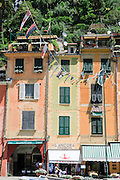 Pastel painted houses on the seafront at Portofino, Golfo del Tigullio, Italian Riviera, Liguria, Italy