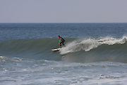 Surfer riding on the wave at the Marconi Beach, Cape Cod, Massachusetts, USA, September 3, 2011.