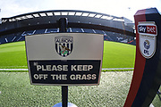Sky Bet branding with Keep off the grass sign during the EFL Sky Bet Championship match between West Bromwich Albion and Huddersfield Town at The Hawthorns, West Bromwich, England on 22 September 2019.