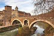 The Tiber - Tiber Island - and the Ponte Fabricio, Ponte dei Quattro Capi also called, in Rome, Lazio, Italy.