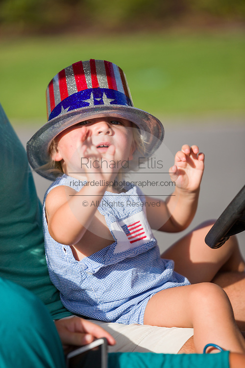 A young girl wearing patriotic costume waves during the Sullivan's Island Independence Day parade July 4, 2015 in Sullivan's Island, South Carolina.