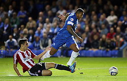 Peterborough United's Nathaniel Mendez-Laing is fouled by Brentford's Raphael Calvet for a penalty - Photo mandatory by-line: Joe Dent/JMP - Tel: Mobile: 07966 386802 08/10/2013 - SPORT - FOOTBALL - London Road Stadium - Peterborough - Peterborough United V Brentford - Johnstone's Paint Trophy