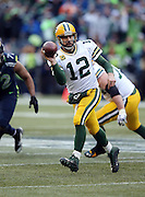 Green Bay Packers quarterback Aaron Rodgers (12) throws a late fourth quarter pass during the NFL week 20 NFC Championship football game against the Seattle Seahawks on Sunday, Jan. 18, 2015 in Seattle. The Seahawks won the game 28-22 in overtime. ©Paul Anthony Spinelli