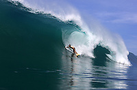 Surfing a huge wave on the coast of Sumatra, Indonesia