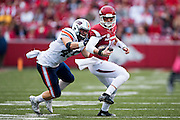 FAYETTEVILLE, AR - OCTOBER 31:  Brandon Allen #10 of the Arkansas Razorbacks is grabbed from behind by Caleb Counce #45 of the UT Martin Skyhawks at Razorback Stadium on October 31, 2015 in Fayetteville, Arkansas.  The Razorbacks defeated the Skyhawks 63-28.  (Photo by Wesley Hitt/Getty Images) *** Local Caption *** Brandon Allen; Caleb Counce
