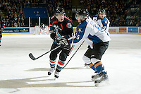 KELOWNA, CANADA, NOVEMBER 25: Zach Franko #9 of the Kelowna Rockets is checked by Jagger Dirk #5 of the Kootenay Ice as the Kootenay Ice visit the Kelowna Rockets  on November 25, 2011 at Prospera Place in Kelowna, British Columbia, Canada (Photo by Marissa Baecker/Shoot the Breeze) *** Local Caption *** Zach Franko; Jagger Dirk;