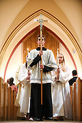 Altar server Matthew Zimmerman of Barnard leads the recessional after confirmation mass at St. Anthony's in White River Junction, Vt. Monday, May 4, 2015. In his first visit to the parish, Bishop Christopher Coyne, of the Roman Catholic Diocese of Burlington, confirmed more than a dozen young people during the mass. Confirmation, the fourth of seven sacraments, is the third sacrament of initiation and is the moment young people re-affirm their faith by their own choosing.   (Valley News - James M. Patterson)<br /> Copyright &copy; Valley News. May not be reprinted or used online without permission. Send requests to permission@vnews.com.