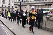 City Officers and officials help proclaim the disolving of parliament on the day that the period of Britain's general election starts. Accompanied by constables in cloaks, the three Esquires: The City Marshall, the Sword Bearer and the Mace Bearer (who is properly called 'the Common Cryer and Sergeant-at-arms'); who run the Lord Mayor's official residence, announces from the steps of Royal Exchange, Cornhill, to the capital's ancient financial district.