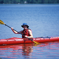 Weld, ME. A kayaker on Webb Lake in Mt. Blue State Park. Northern Forest.