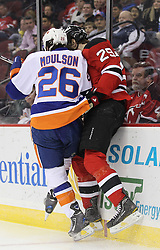 Mar 8; Newark, NJ, USA; New York Islanders left wing Matt Moulson (26) hits New Jersey Devils defenseman Mark Fayne (29) during the first period at the Prudential Center.