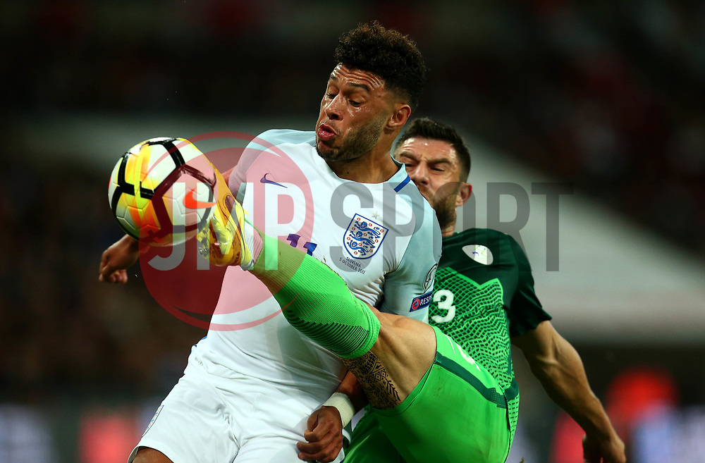 Alex Oxlade-Chamberlain of England is challenged by Bojan Jokic of Slovenia - Mandatory by-line: Robbie Stephenson/JMP - 05/10/2017 - FOOTBALL - Wembley Stadium - London, United Kingdom - England v Slovenia - World Cup qualifier