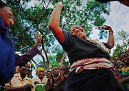 Gender violence program coordinator Sydia Nduna, from Zambia, begins a women's block meeting with a dance to relax participants. Nduna offers confidential counseling to sexually abused refugee women from Burundi living in the camps in the Kibondo district in northern Tanzania.